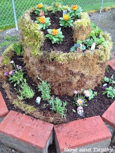 Spiral Herb Garden From Recycled Materials and Moss