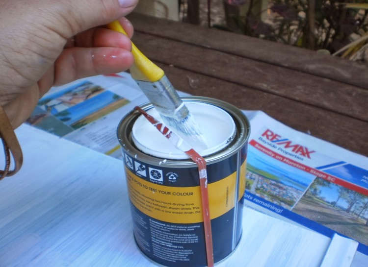 Put a thick rubber band around the paint can to wipe excess paint on instead of the rim