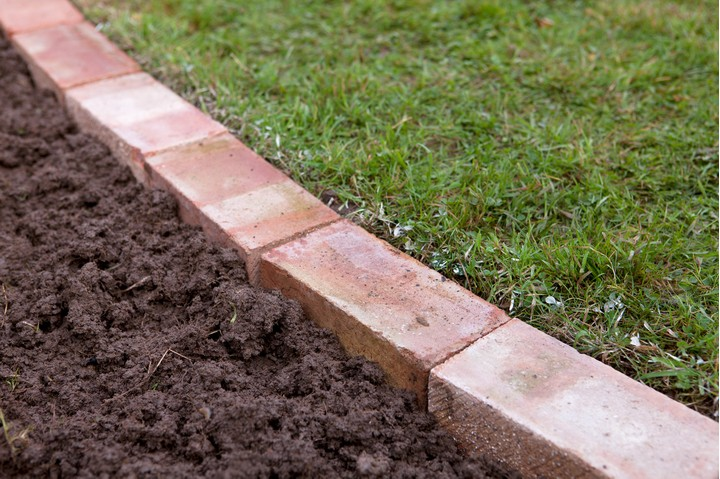 Edge a lawn with bricks