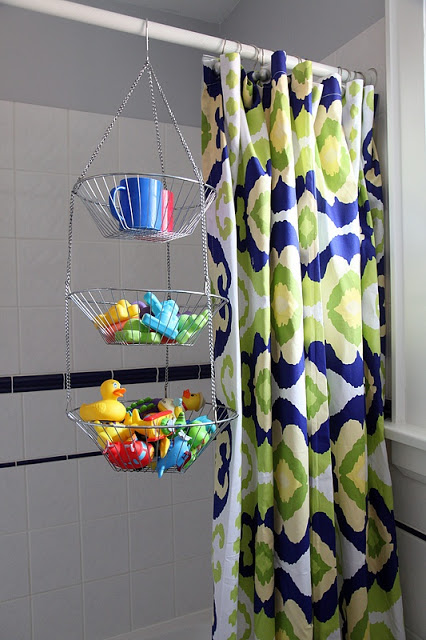 Use a hanging tiered fruit basket to hold bath toys